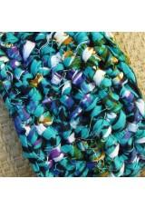 Manchette en wax turquoise, violet, noir, vert et orange
