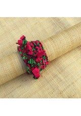 Manchette en wax rose, vert et noir avec franges